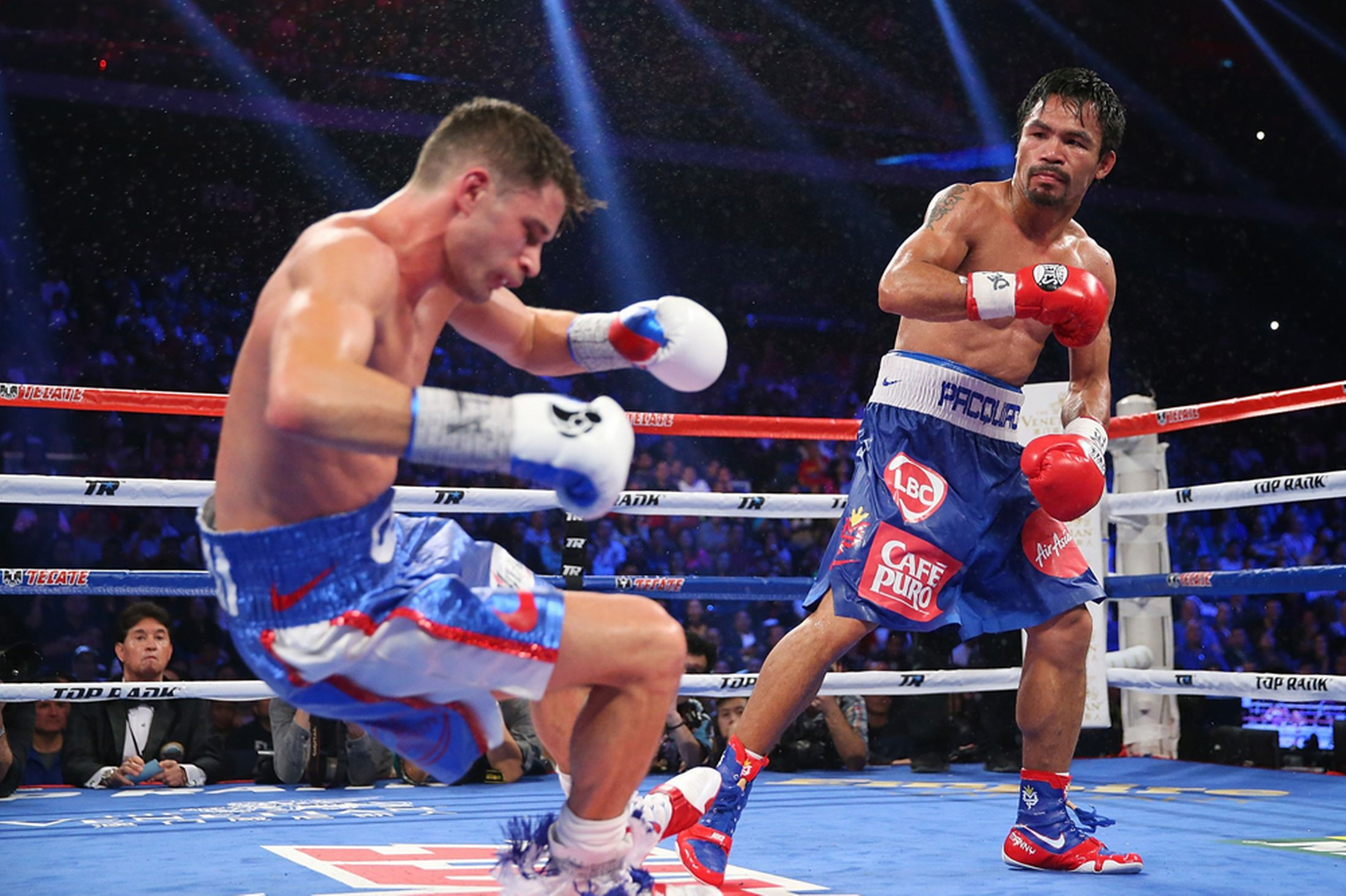 Manny-Pacquiao-knocks-down-Chris-Algieri