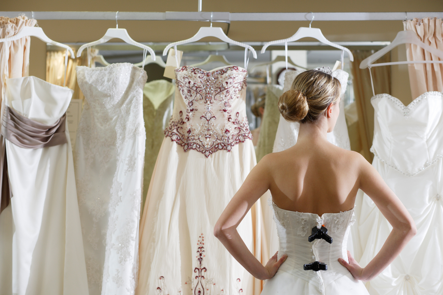 girl-looking-at-wedding-dresses-main